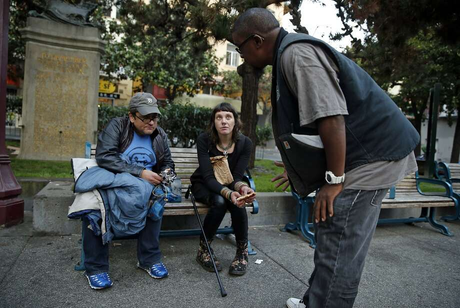 Hugh Gregory of the Homeless Outreach Team tries to convince homeless man Lee Messina to relocate from Portsmouth Square to the Navigation Center in the Mission District with fellow homeless person Katrina Newsome. Photo: Scott Strazzante, The Chronicle
