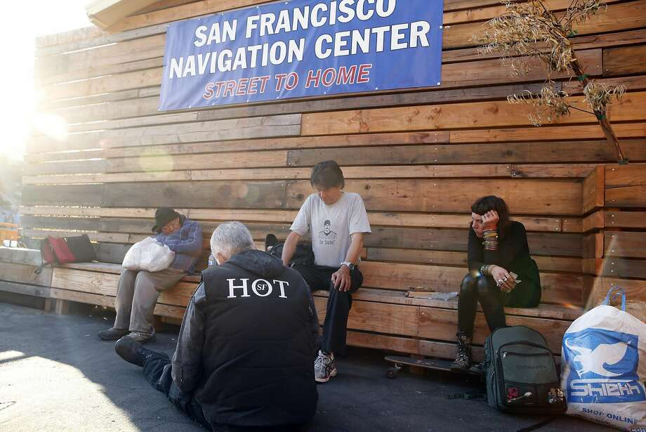 SF Homeless Outreach Team's Patrick Gillespie interviews  Jimmy Lee, Chris Torres and Katrina Newsome after they arrived at the Navigation Center in the Mission District in San Francisco, Calif., on Tuesday, October 13, 2015. Photo: Scott Strazzante, The Chronicle
