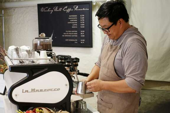 Nick Cho steams milk as he creates 'Karl the Latte' at Wrecking Ball Coffee in San Francisco Wednesday October 13, 2015. The latte uses tea and espresso to create a fall themed drink.