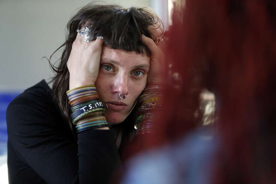 After spending weeks sleeping in Portsmouth Square, homeless woman Katrina Newsome listens as she is admitted into the Navigation Center. Photo: Scott Strazzante, The Chronicle