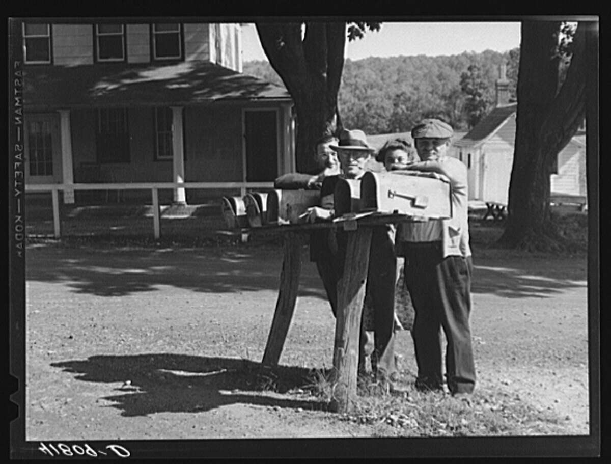 October 1940. A group of Jewish farmers waiting for their mail in the Huntington District, Newtown, Connecticut. Fifteen Jewish farm families live in this district