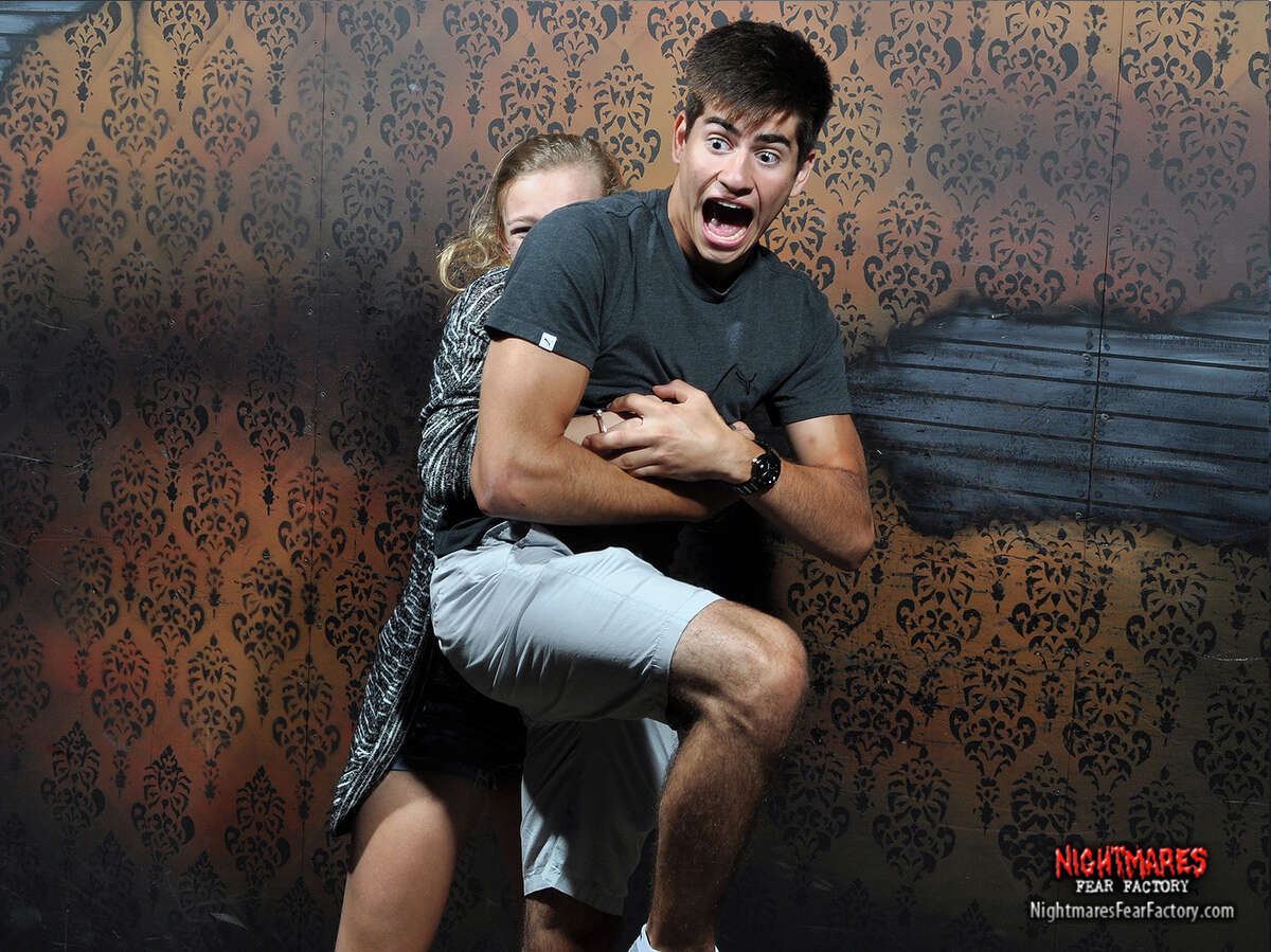 The Nightmares Fear Factory, of course, does not reveal what has made its visitors so scared. You'll have to insert your worst nightmare in each photo.