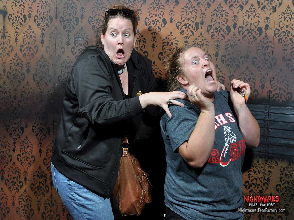 Every year, the Nightmares Fear Factory haunted house in Niagara Falls, Canada releases a selection of photos of its terrified visitors. These are their faces of fear.