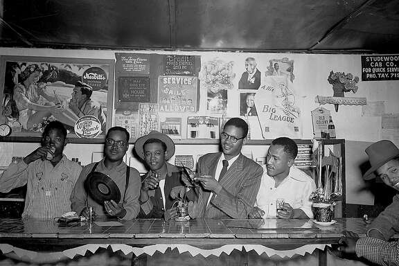 Record Release Party in a Fillmore CafŽ, Circa 1950s. This image by Steve Jackson Jr. is from  the book Harlem of the West, The San Francisco Fillmore Jazz Era, 2006 Chronicle Books by Elizabeth Pepin and Lewis Watts.
