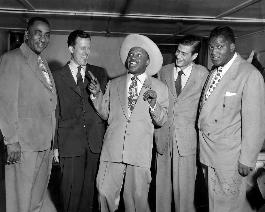 """Lionel Hampton (in ten-gallon hat) with Ralph J. Gleason and others at the Texas Playhouse in an image from the book """"Harlem of the West: The San Francisco Fillmore Jazz Era"""" Elizabeth Pepin and Lewis Watts. Photo: Wesley Johnson Collection, The Wesley Johnson Collection"""
