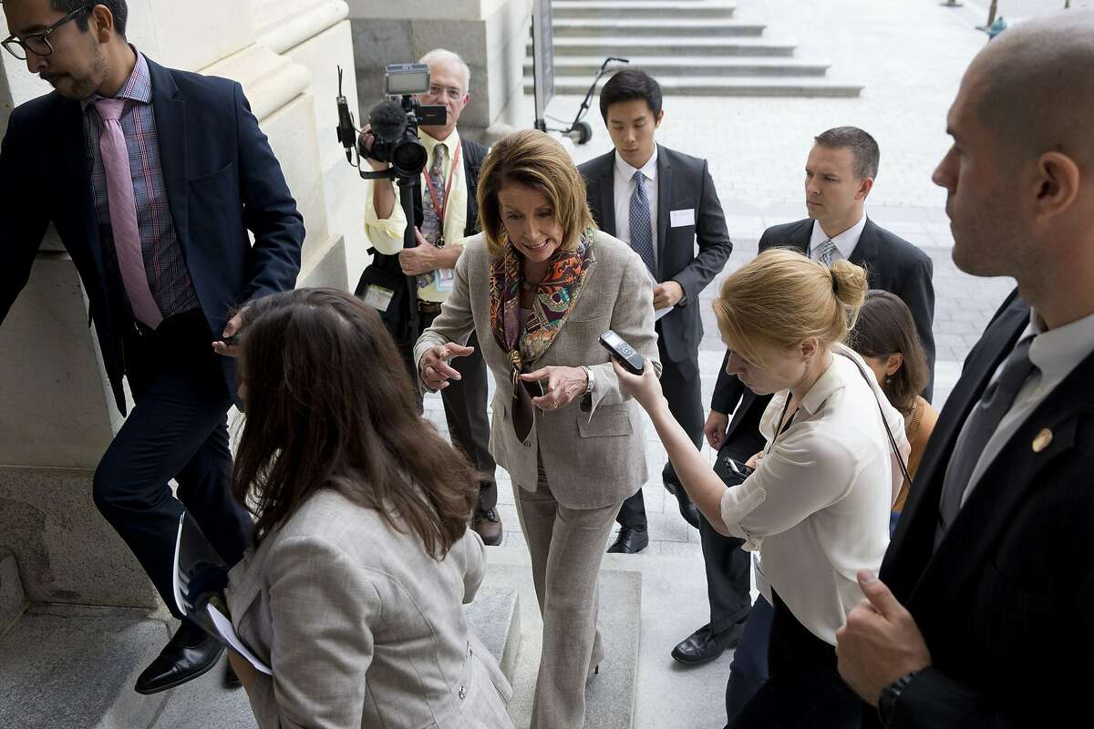 House Minority Leader Nancy Pelosi of Calif., center, is pursued by reporters as she leaves a news conference on Capitol Hill in Washington, Wednesday, Oct. 7, 2015, where she discussed Medicare Part B premiums and deductibles for seniors. (AP Photo/Jacquelyn Martin)