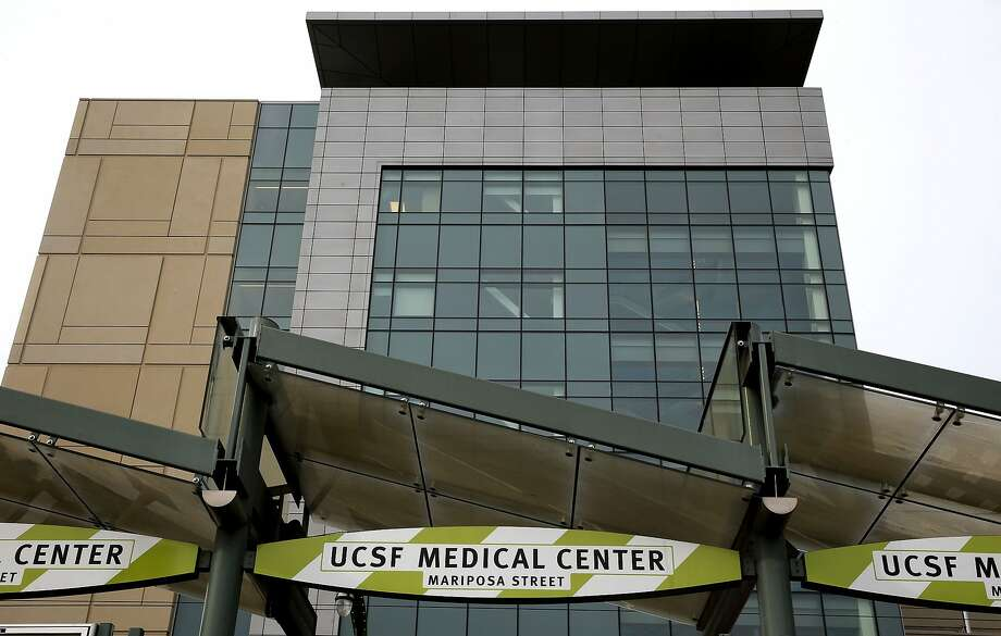 A file photo of Benioff Children's hospital as seen from 3rd street at UCSF Medical Center at Mission Bay in San Francisco. Two dozen custodians who accused UCSF of causing them to lose their  jobs will be hired by UCSF as in-house employees. This means they will have better pay and the full range of benefits offered  UCSF employees than they did when employed by an outside company. Photo: Michael Macor, The Chronicle