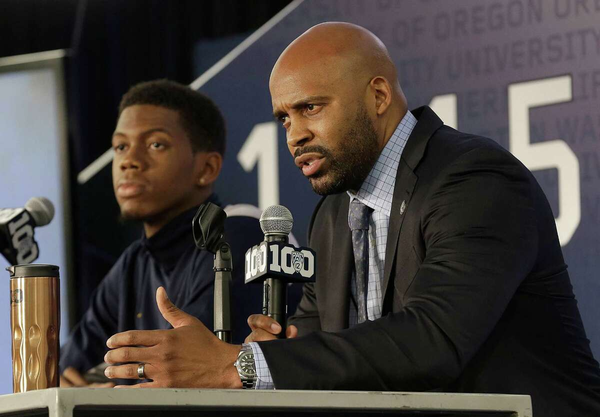California head coach Cuonzo Martin, right, speaks next to Tyrone Wallace during NCAA college basketball Pac-12 media day in San Francisco, Thursday, Oct. 15, 2015. (AP Photo/Jeff Chiu)