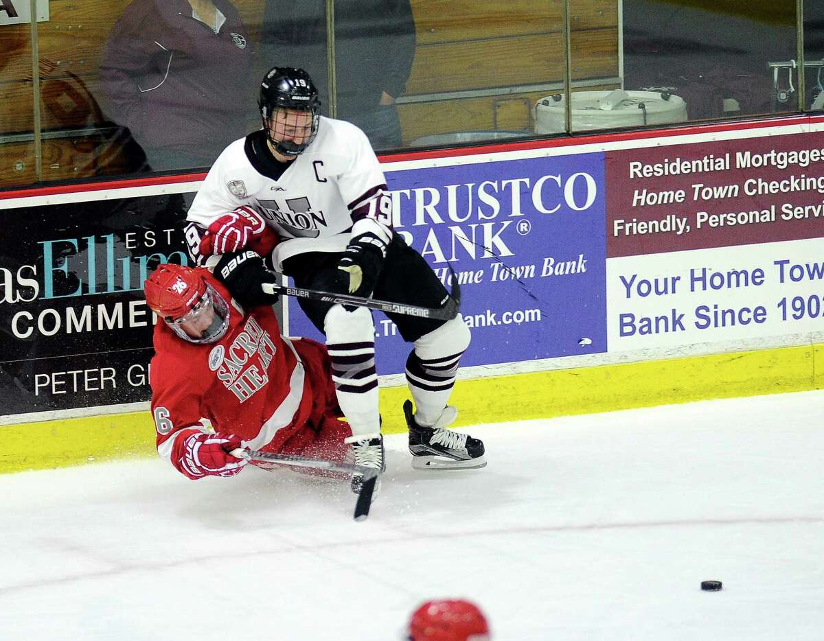Union's Matt Wilkins (19) checks Sacred Heart's Coltyn Hansen (6) in the first period of an NCAA college hockey game Friday, Oct 9, 2015, in Schenectady, N.Y. (Hans Pennink / Special to the Times Union) ORG XMIT: HP103