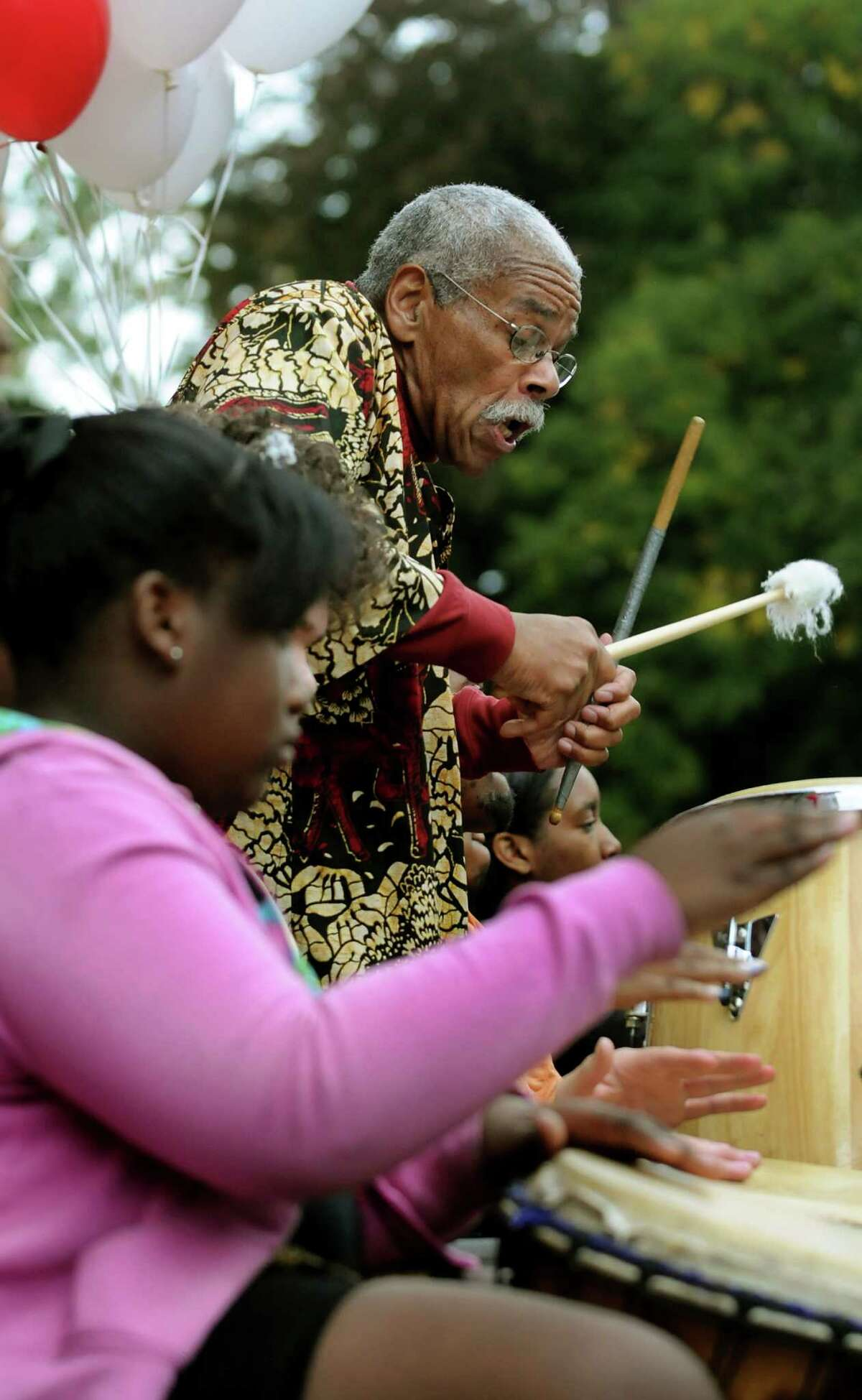 Alan Weeks, director of the Student Theater Outreach Program, right, leads the drummers during a performance before the annual AIDSWalk on Saturday, Sept. 29, 2012, at Washington Park in Albany, N.Y. (Cindy Schultz / Times Union)