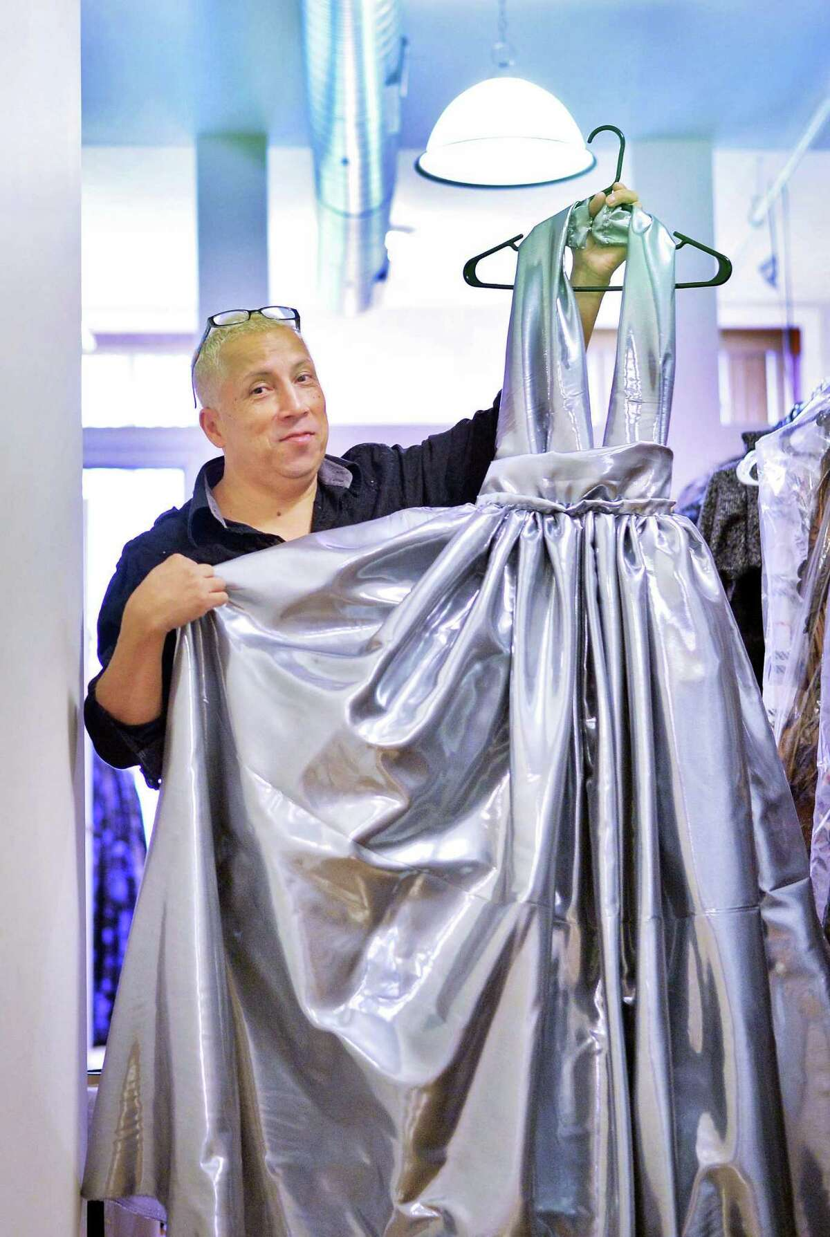 Daniel Mozzes with a silver evening dress at his N. Pearl Street studio Tuesday Oct. 6, 2015 in Albany, NY. (John Carl D'Annibale / Times Union)