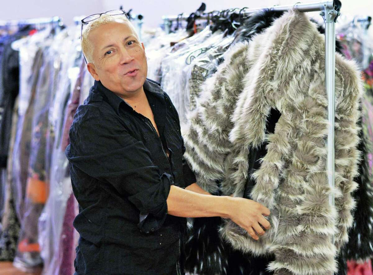 Daniel Mozzes shows off a hand stitched faux fur jacket at his N. Pearl Street studio Tuesday Oct. 6, 2015 in Albany, NY. (John Carl D'Annibale / Times Union)