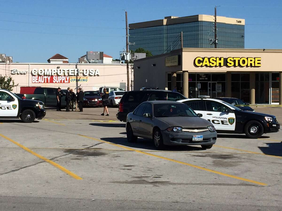An officer shot one of the two suspects in an attempted robbery at the Cash Store near Tidwell on Thursday.