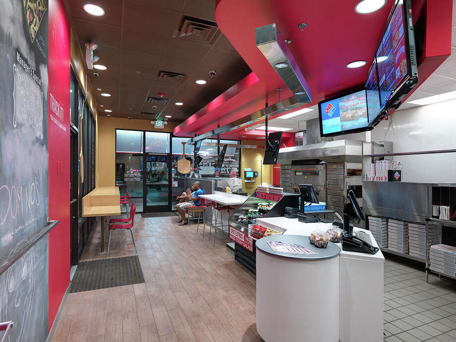 The interior of a Domino's restaurant features the company's new pizza theater concept, which includes a guest lobby and open viewing of the pizza making process. Photo: Courtesy Domino's, Independent Commercial Photograp / © Steve Maylone THIS IS NOT PUBLIC DOMAIN