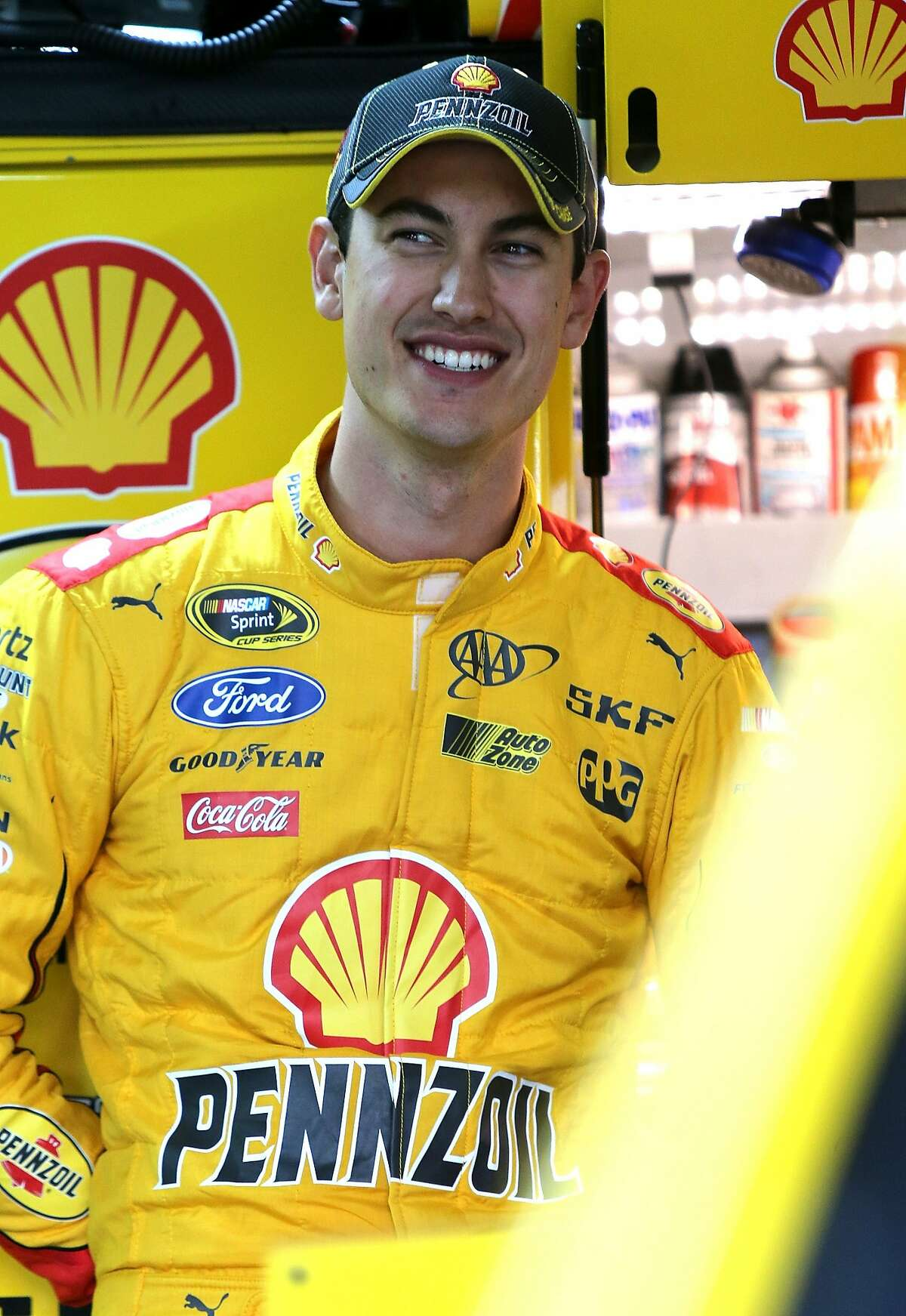 CHARLOTTE, NC - OCTOBER 09: Joey Logano, driver of the #22 Shell Pennzoil Ford, stands in the garage area during practice for the NASCAR Sprint Cup Series Bank of America 500 at Charlotte Motor Speedway on October 9, 2015 in Charlotte, North Carolina. (Photo by Jerry Markland/Getty Images)