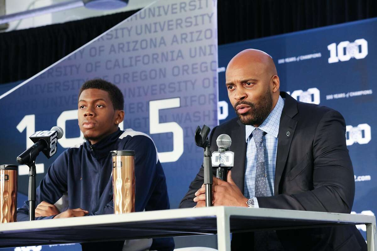 Tyrone Wallace, California's senior guard, and his coach Cuonzo Martin address pre-season questions from the media at Pac -12 men's basketball media day in San Francisco, California on Thursday, October 15, 2015.