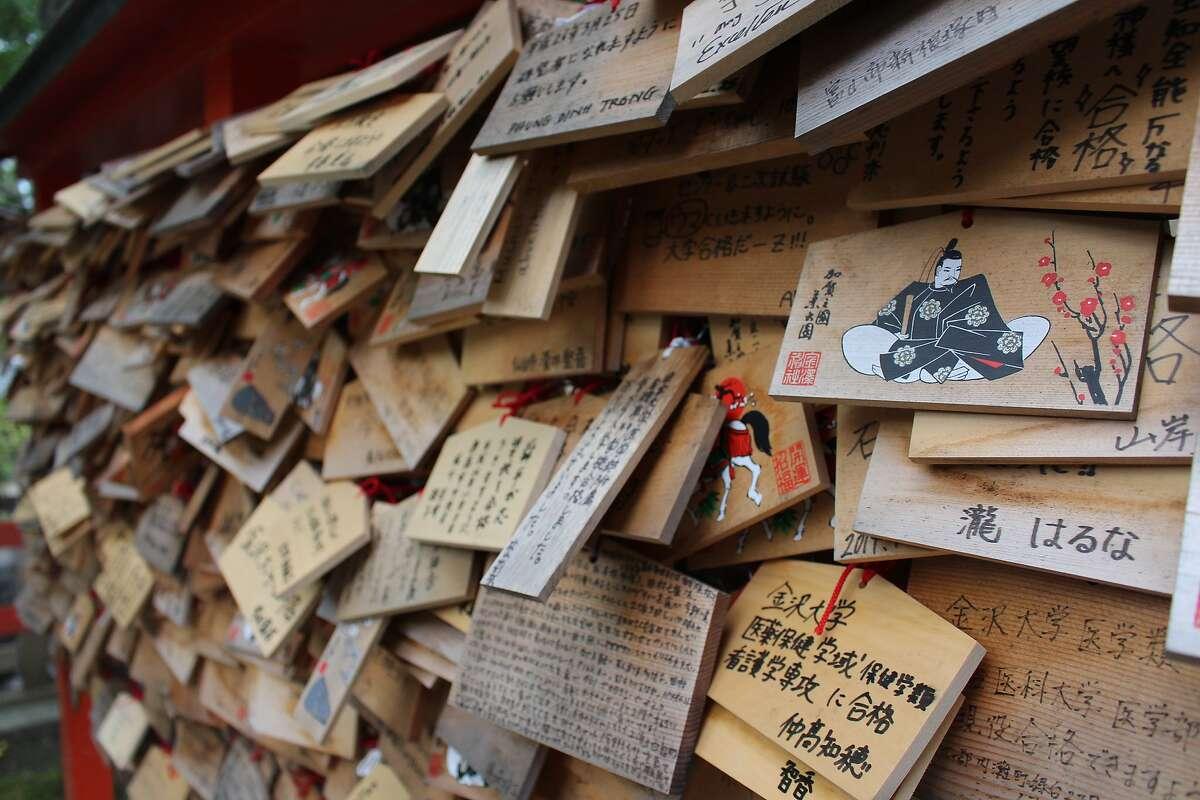 Ema wooden blocks decorate a shinto shrine in the Kenroku-en Garden.