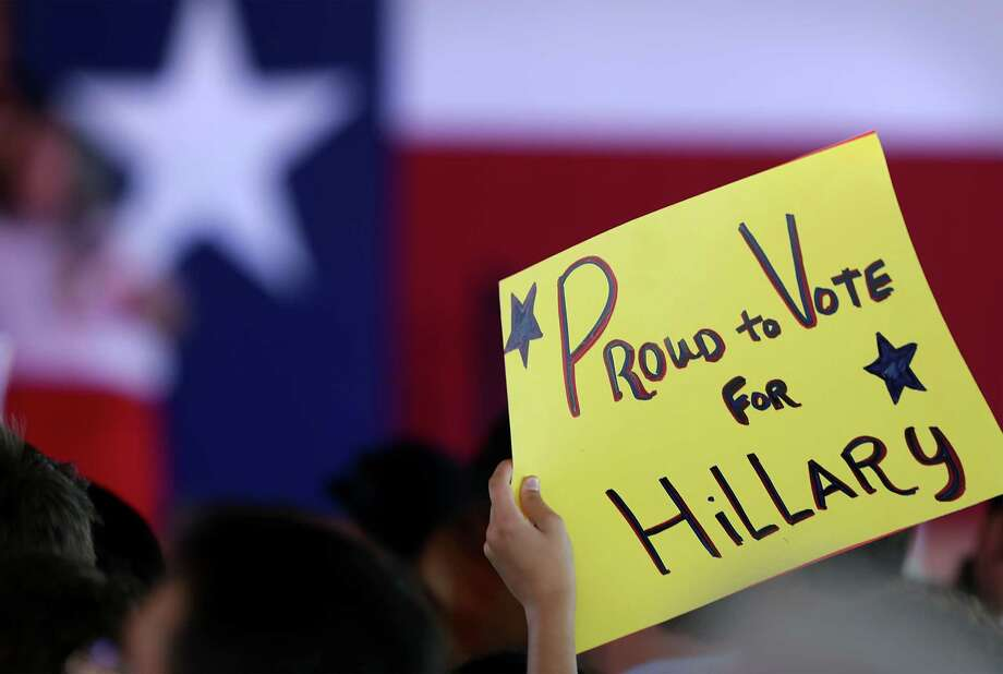 A supporter for Presidential candidate Hillary Clinton holds a sign at a rally on Thursday, Oct. 15, 2015 at Sunset Station in San Antonio. Photo: BOB OWEN, San Antonio Express-News / San Antonio Express-News