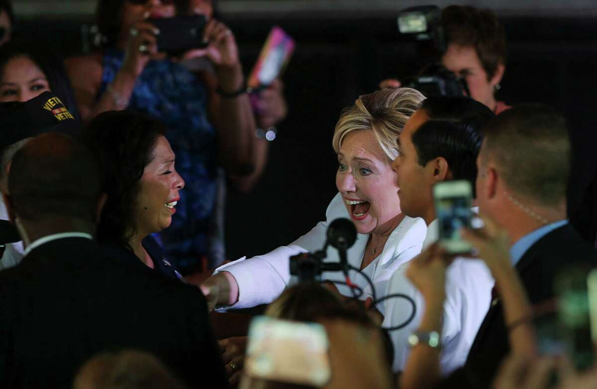 """Presidential candidate Hillary Clinton, center, and Housing Secretary Julián Castro, right, greet supporters at a """"Latinos for Hillary"""" rally at Sunset Station."""