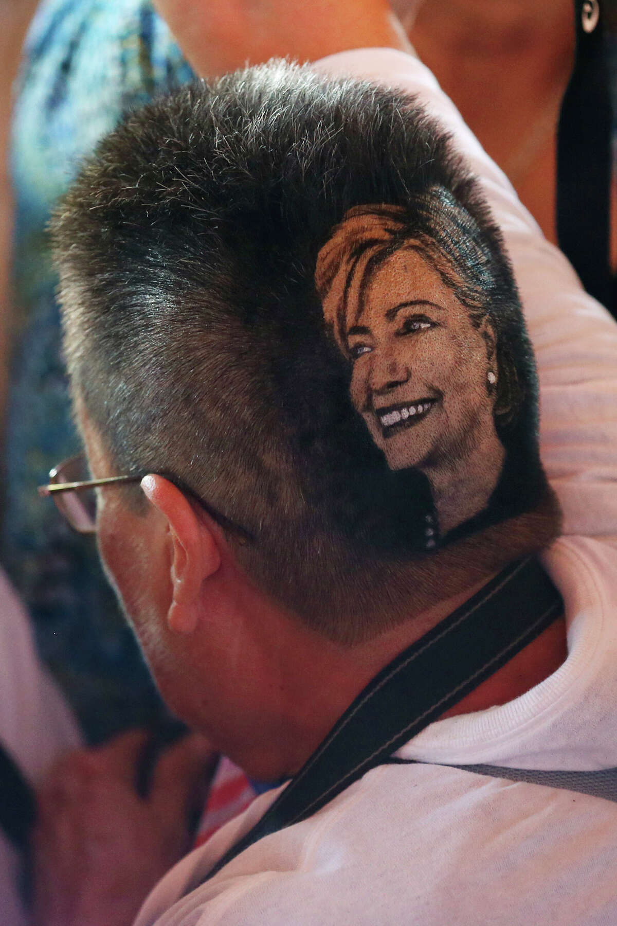 Maria Anita Monsivaiz sports a haircut in Democratic presidential candidate Hillary Clinton's image during a rally for Clinton at Sunset Station. The crowd numbered in the thousands and was predominately Hispanic. Before the rally, Clinton attended a Q&A session with members of the U.S. Hispanic Chamber of Commerce. The haircut was the design of local barber, Rob the Original.