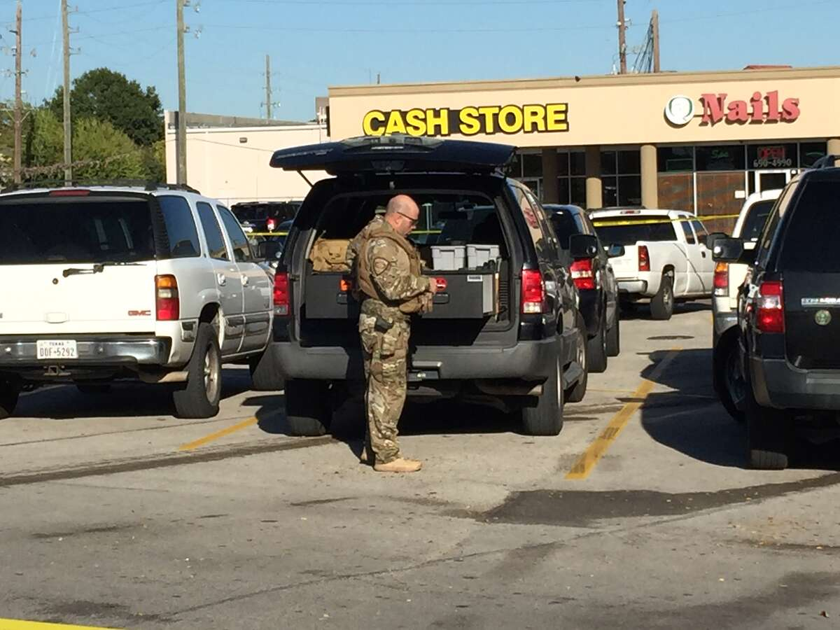A SWAT team was called to the scene of the Cash Store robbery on Tidwell near U.S. 290 on Thursday.