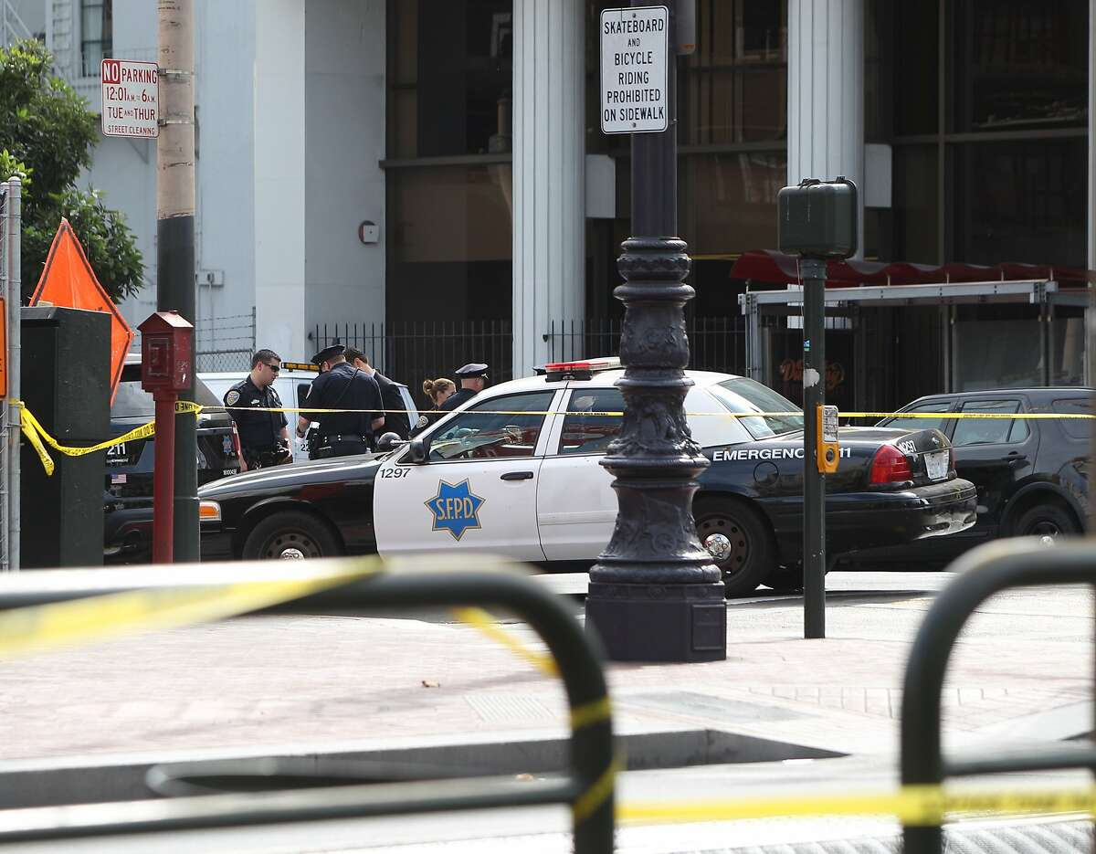 Officers and the corners van at the taped off intersections of Market and 8th streets, as they investigate an officer involved shooting that resulted in the death of the suspect. October 15, 2015.