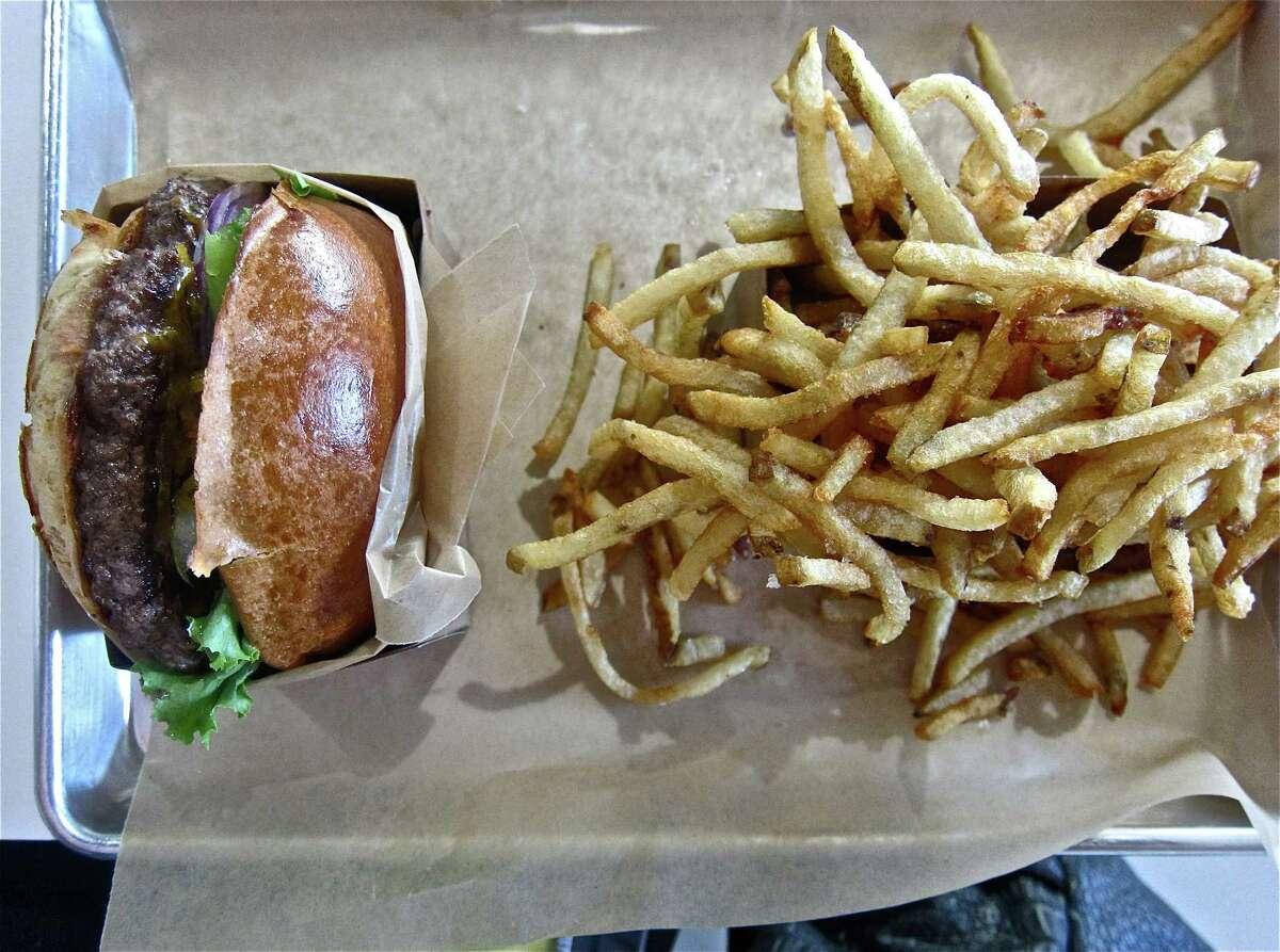 Tray service at Buff Burger, with cheeseburger and fries.