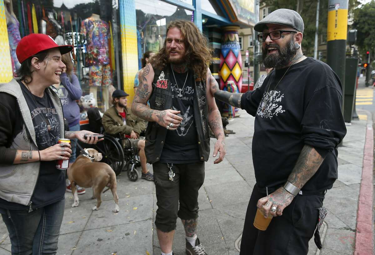 Christian Calinsky (right) meets with Maggie May (left) and Davis Wood (center) in San Francisco, Calif. on Thursday, Oct. 15, 2015. Calinsky runs the Taking It to the Streets program, which provides teens and young adults living on the streets an opportunity to clean up the Haight Ashbury neighborhood in exchange for housing and social services.