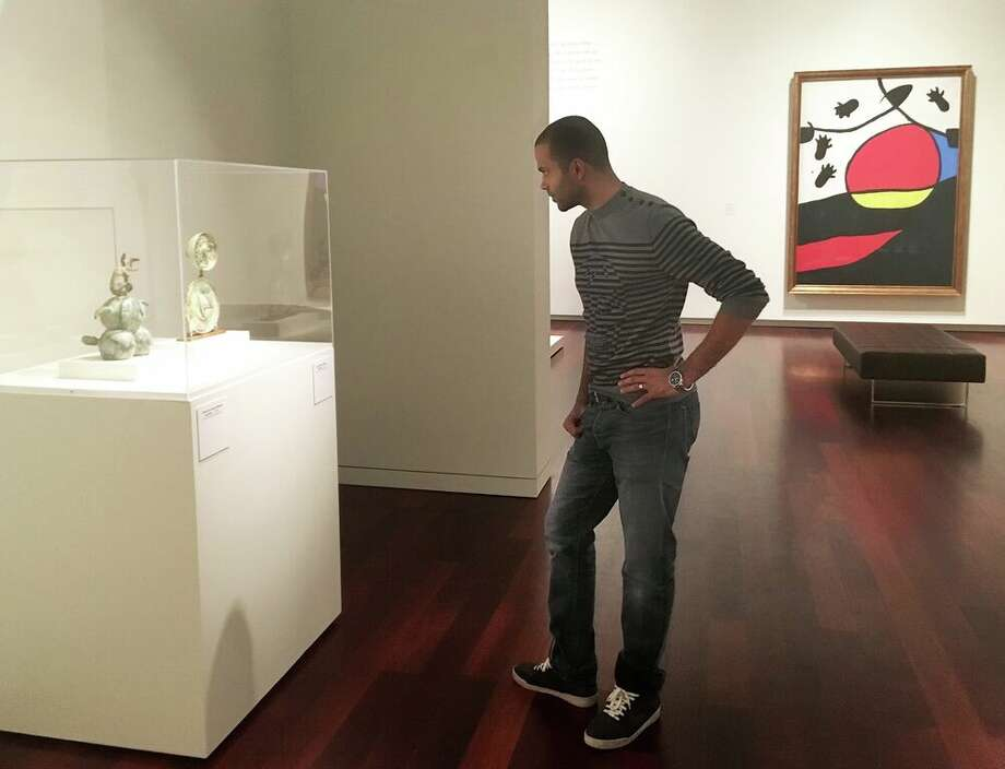 Spur Tony Parker looks at two small-scale sculptures by Joan Miró at the McNay Art Museum. Photo: Courtesy McNay Art Museum