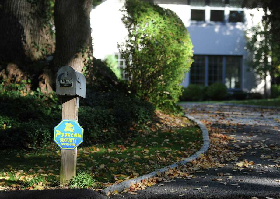 A security sign stands outside a home in Greenwich on Thursday. Photo: Tyler Sizemore / Hearst Connecticut Media / Greenwich Time