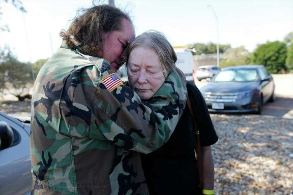 Smithville resident David Parrott consoles his weary and sleep-deprived mother, Sherry, over the loss of Sherry's home while awaiting to enter a shelter set up at the Smithville Recreation Center on Thursday, Oct. 15, 2015. Like the Parrotts, Bastrop County residents have dealt with evacuating their homes due to the Hidden Pines Fire. Firefighters continue to contain the flames that have now spread to more than 4,200 acres in Bastrop County according to the Texas A&M Forest Service. (Kin Man Hui/San Antonio Express-News)