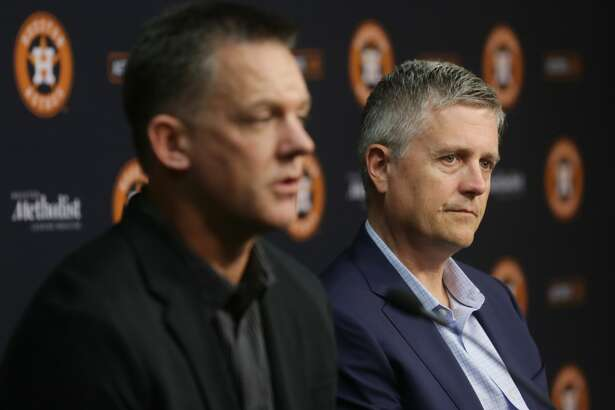 Jeff Luhnow, general manager of the Houston Astros, right, listens as A. J. Hinch, manager of the Houston Astros, speaks during the season-ending press conference at Minute Maid Park, Thursday, Oct. 15, 2015, in Houston. The Astros were eliminated from the playoffs the night before after losing to the Kansas City Royals in game five of the ALDS. ( Jon Shapley / Houston Chronicle )