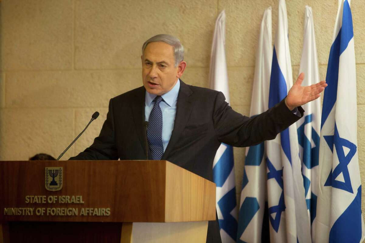 """Israeli Prime Minister Benjamin Netanyahu gestures as he speaks during a press conference at the Foreign Ministry in Jerusalem, Thursday, Oct. 15, 2015. Netanyahu on Thursday said he would be """"perfectly open"""" to meeting with Palestinian President Mahmoud Abbas in order to end weeks of Israeli-Palestinian unrest. (AP Photo/Sebastian Scheiner)"""