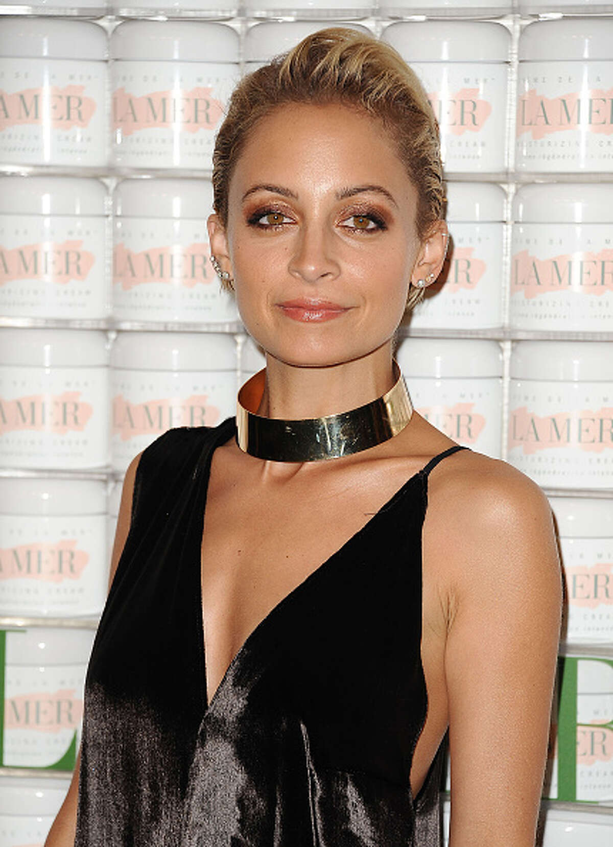 Celebrities you didn't know were adopted: Nicole Richie Richie was adopted by Lionel Richie (her biological father's band mate) at the age of thee for financial reasons.