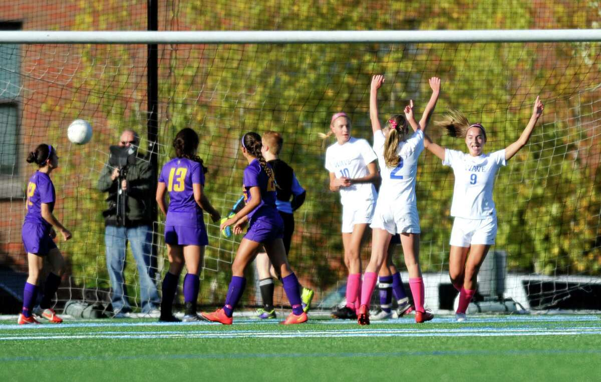 Darien sophomore Charlotte Harmon, number 9, celebrates after scoring the games first goal with teammates Nathalie Bravo, 2, and Katie Ramsay, 10, in a Thursday afternoon varsity girls soccer match against Westhill on Oct. 15, 2015 at Darien High School.