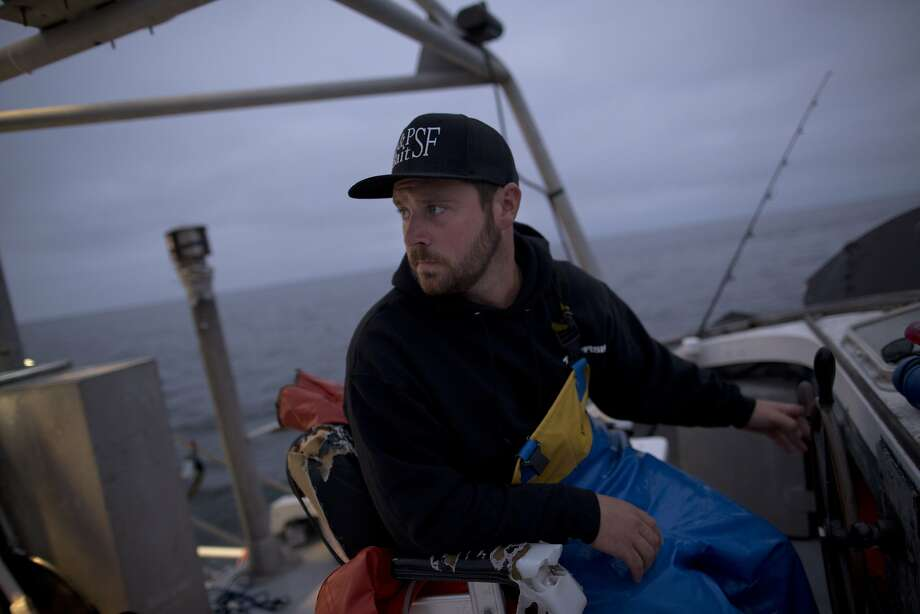 Erik Sandquist, 28, captains the Mya Nicole as he searches for schools of anchovies in the Pacific Ocean. Photo: Tim Hussin, The Chronicle