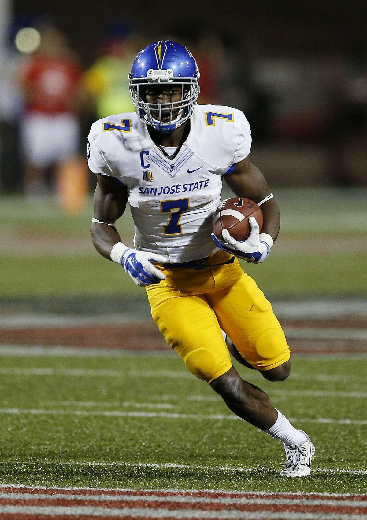 San Jose State running back Tyler Ervin (7) runs against UNLV during an NCAA college football game Saturday, Oct. 10, 2015, in Las Vegas. (AP Photo/John Locher)
