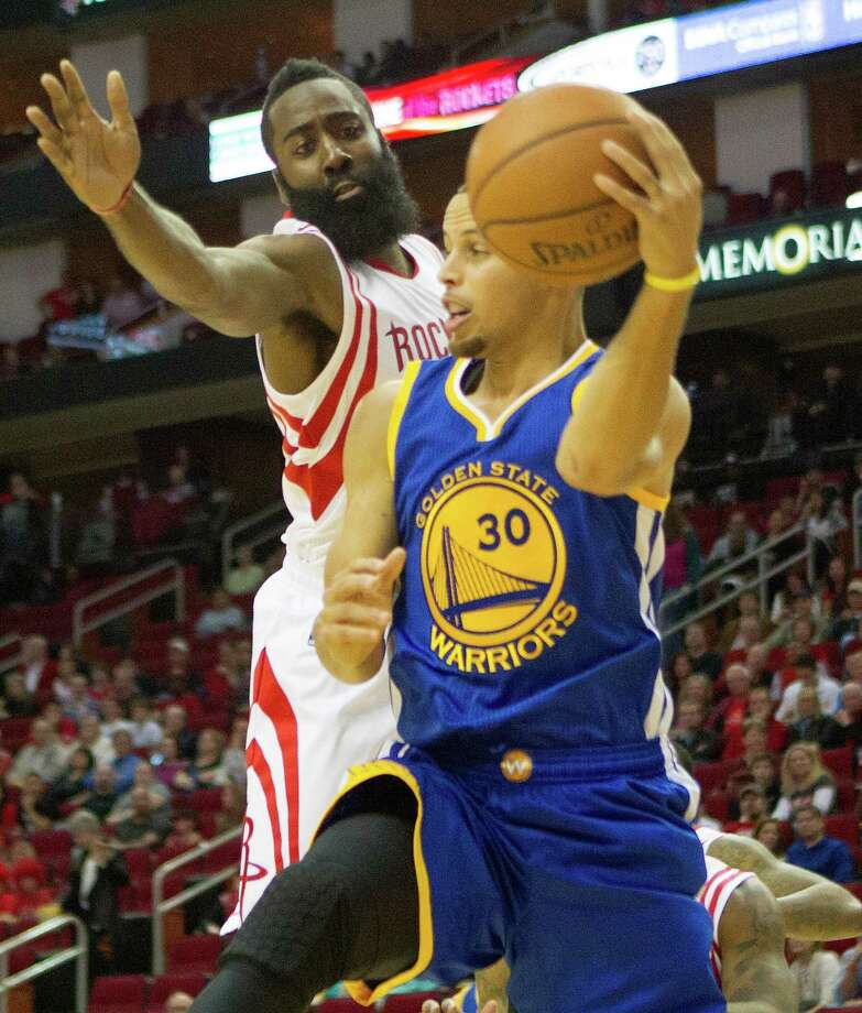 After a runner-up finish to Stephen Curry (right) last season, James Harden was ninth in this year's NBA MVP voting. Photo: Cody Duty, Staff / © 2014 Houston Chronicle