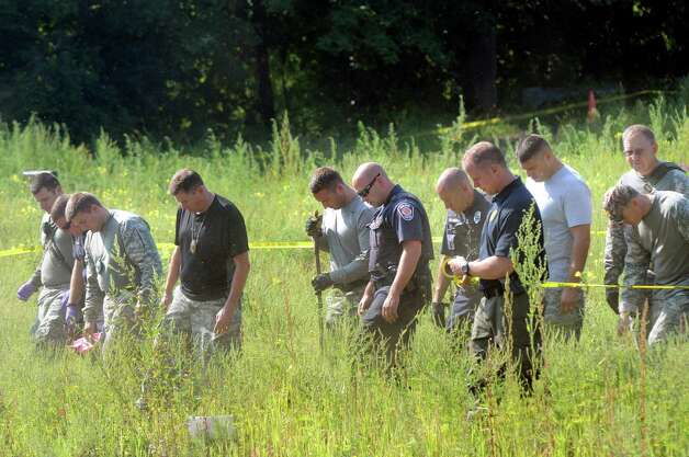 Colonie Police and EMS search for evidence at Everett and Sand Creek roads on Tuesday, Aug. 25, 2015, Colonie, N.Y. They were searching near the area where barber Jacquelyn Porreca, 32, was stabbed and killed on Aug. 21. (Cindy Schultz / Times Union archive) Photo: Cindy Schultz / 00033123A