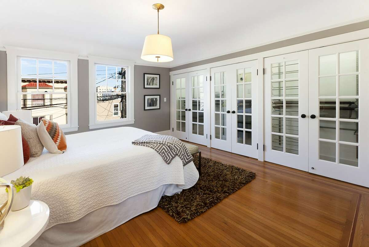 Inlaid hardwood flooring is found throughout the four-bedroom home.
