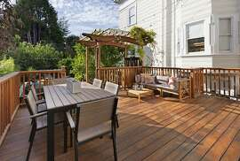 The backyard's walk-out Ipe deck leads to a hot tub and outdoor shower.