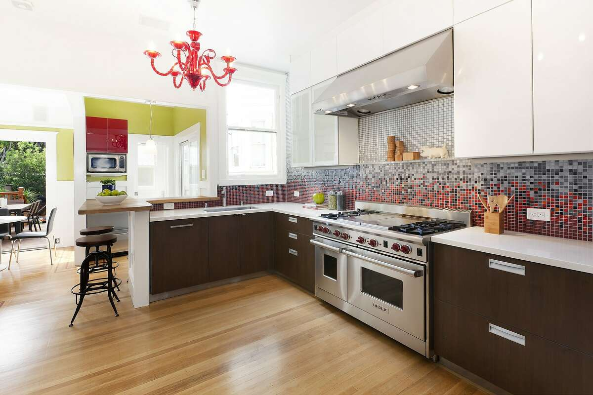 The remodeled gourmet kitchen includes professional appliances and bar seating.