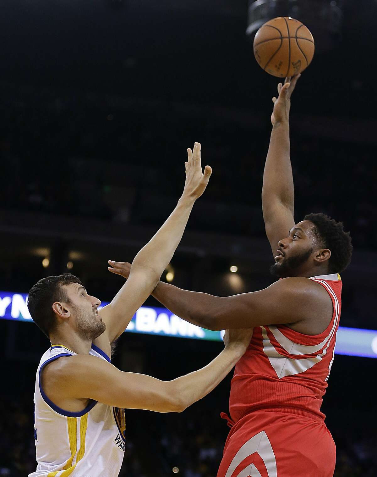 Houston Rockets' Joshua Smith, right, shoots over Golden State Warriors' Andrew Bogut during the first half of an NBA preseason basketball game Thursday, Oct. 15, 2015, in Oakland, Calif. (AP Photo/Ben Margot)
