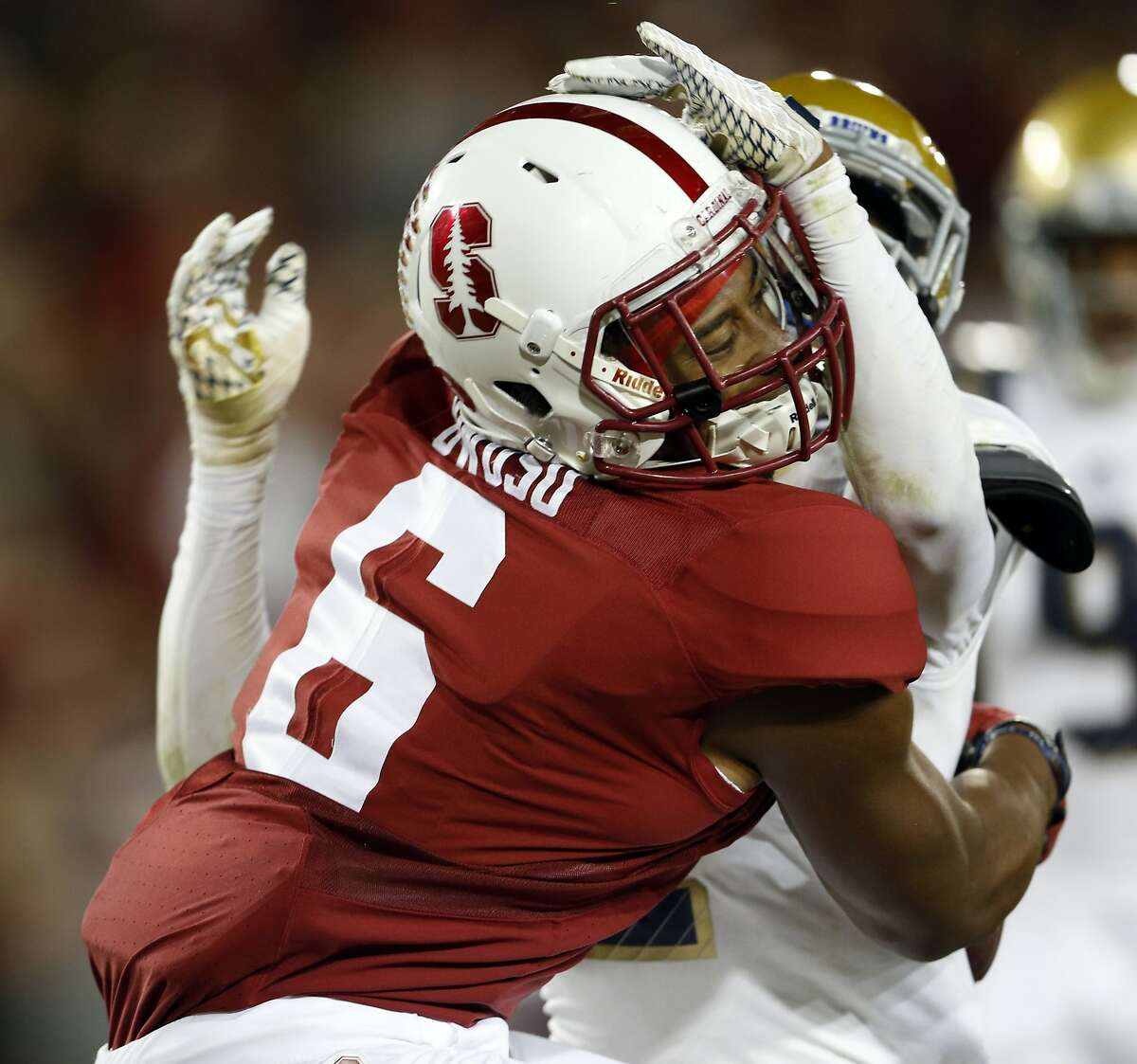 Stanford's Francis Owusu catches a touchdown pass against the back of UCLA defender Jaleel Wadood in 3rd quarter during Pac 12 football game at Stanford Stadium in Stanford, Calif., on Thursday, October 15, 2015.