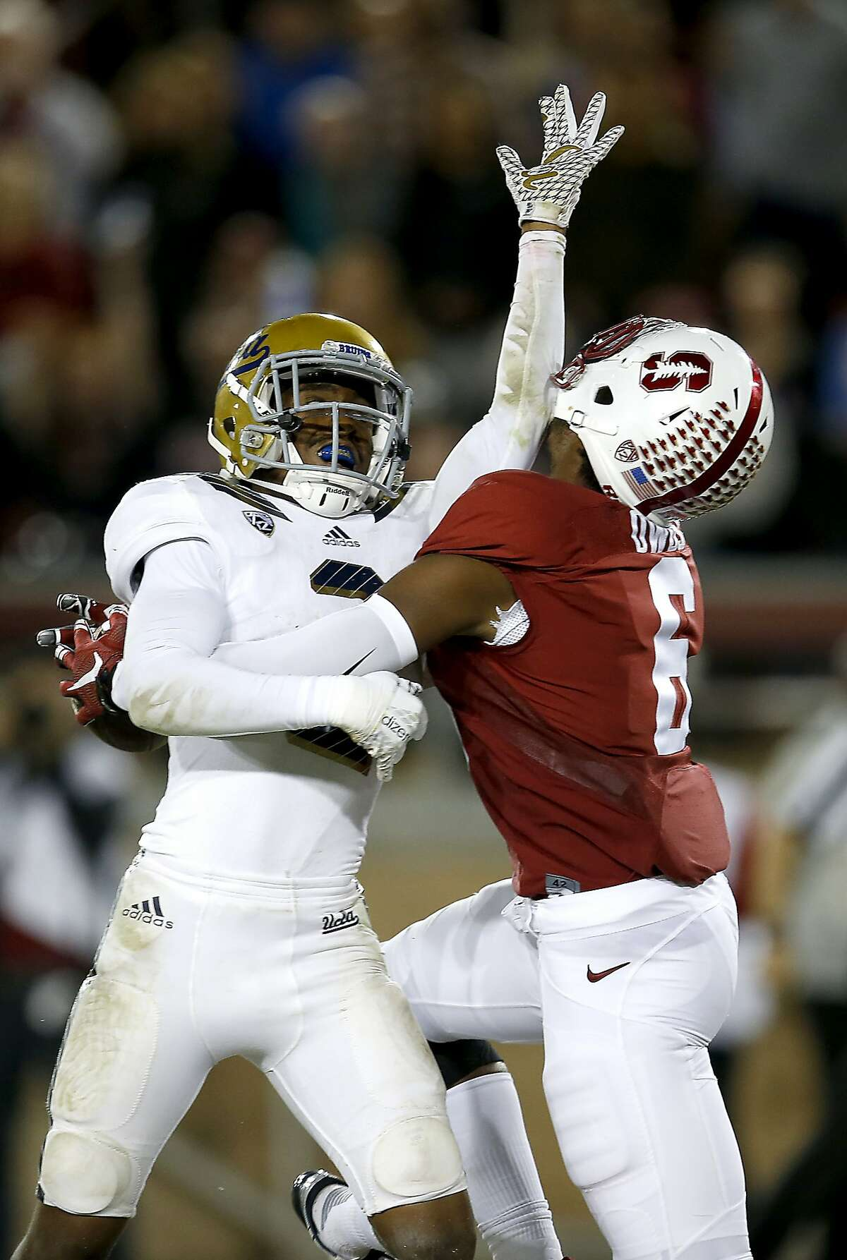 Stanford wide receiver Francis Owusu (6) catches a touchdown pass behind the back of UCLA defensive back Jaleel Wadood during the second half of an NCAA college football game Thursday, Oct. 15, 2015, Stanford, Calif.