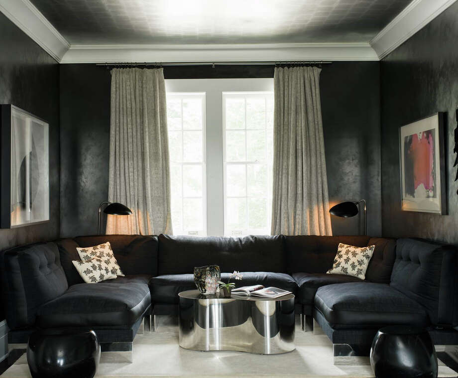The bedroom at interior designer Kristin Fine's home is painted black with silver ceilings. Fine said she feels she can take greater risks when designing her own home. Photo: Contributed / Contributed Photo / Greenwich Time Contributed