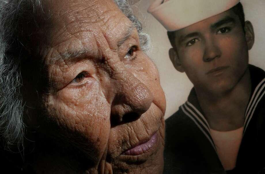 Juanita Segovia, 84, still mourns son Heriberto Hernan dez, who died in a firefight in Vietnam in late 1968. Photo: Billy Calzada /San Antonio Express-News / San Antonio Express-News