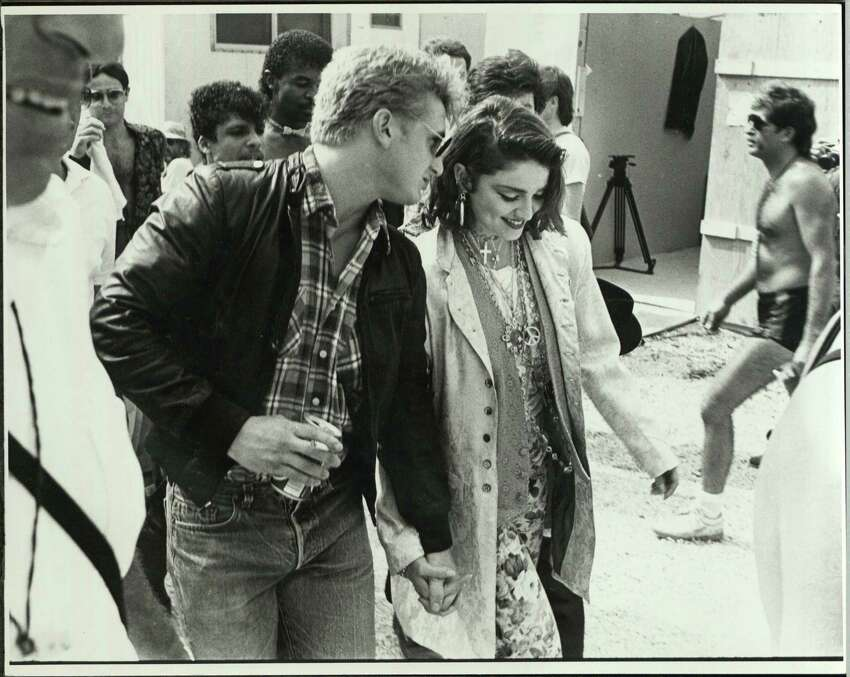 American musician Madonna and her fiancee, actor Sean Penn, at John F Kennedy Stadium for Live Aid concert where she performed, Philadelphia, Pennsylvania, July 13, 1985.