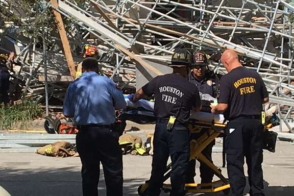 Several people are feared trapped after scaffolding collapsed Friday morning, Oct. 16, 2015, at building in downtown Houston near Minute Maid Park.
