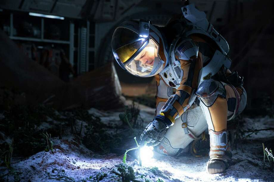 """In """"The Martian,"""" the No. 1 film at the box office for two weeks in a row, an astronaut portrayed by Matt Damon survives by growing his own food. Photo: Giles Keyte, HONS / 20th Century Fox"""